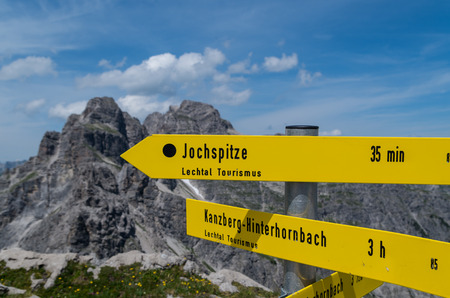 allgau: Signpost for hikers in the Allgau mountains near Oberstdorf at the border of Germany and Austria Stock Photo