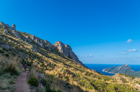 baleares: Female hiking in the mountains at the coast of Tramuntana, Mallorca, Baleares, Spain Stock Photo