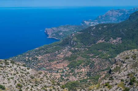 baleares: Panorama of Deia and the beautiful coastloine from the mountains of Tramuntana, Baleares, Spain