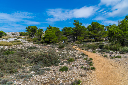 mediterrean: Female hiking in the mountains of Tramuntana, Mallorca, Balearic Islands, Spain Stock Photo