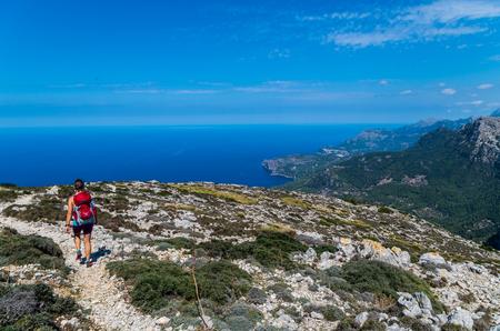 Female hiking in the mountains of Tramuntana, Mallorca, Balearic Islands, Spain Stock Photo