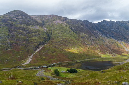 Aonach Eagach ridge above Loch Achtriochtan in Glencoe, Scotland, Great Britain