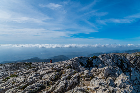 Female hiking on the GR 221 in the mountains at the coast of Tramuntana, Mallorca, Baleares, Spain Фото со стока