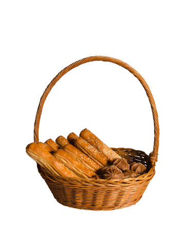 basket with bread: Basket, bread sticks and candy isolate