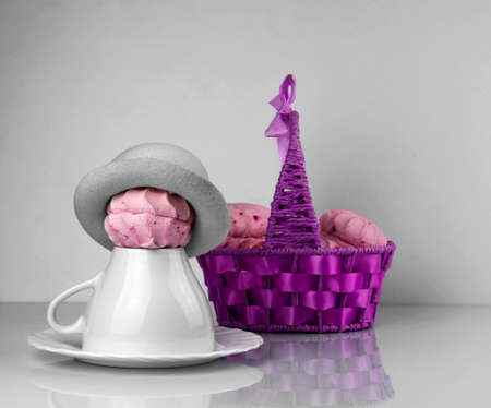 zephyr: Zephyr purple basket, cup  saucer and Zephyr in a hat Stock Photo