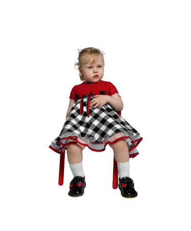 ate: Little girl and she ate sitting on a red chair and childrens rest