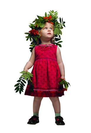 mountain ash: Little girl with a wreath of twigs and fruits of mountain ash on his head and Rowan branches in their hands Stock Photo