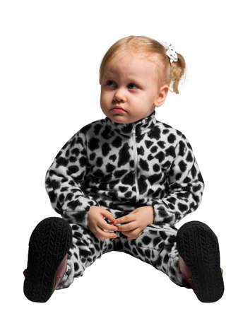 outsole: Little girl dressed as a Dalmatian sitting on white isolate