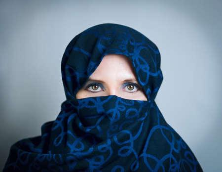 chastity: Woman in a blue-black portrait paranzhe photo studio Stock Photo