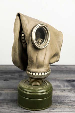 Vintage green mask on a wooden background