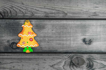 your text: Christmas tree cookie on a gray wooden background your text Photo