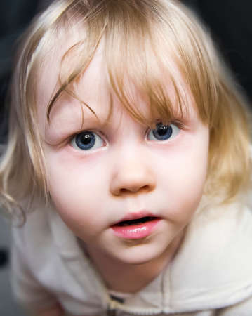 smile please: Beautiful little girl the blonde with huge blue eyes looking up in fear, wonder and amazement