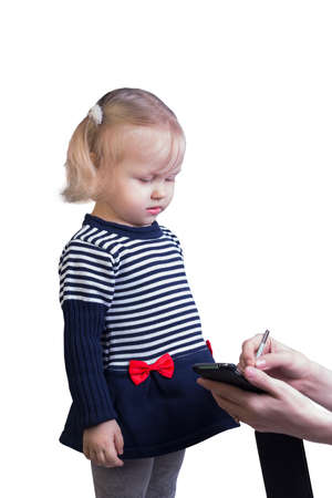 isolates: Woman teaching little girl the blonde on a smartphone stylus to draw on the screen - isolates on white Stock Photo