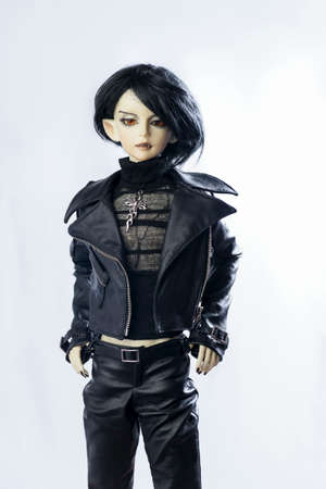 jointed: MOSCOW, RUSSIA - November 14, 2015: On a wooden table limited ball jointed doll male vampire-elf Kalix created by DOD (Dream Of Doll) in black leather outfit