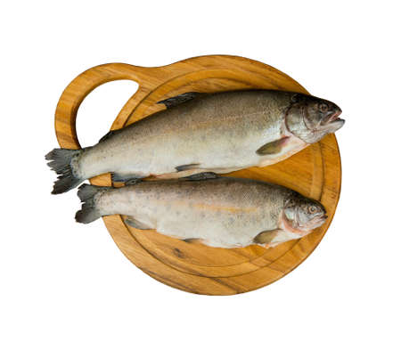 Fresh raw fish trout is two pieces on the board for cutting food top view - isolated on white