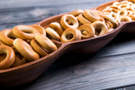 baranka: On a gray wooden background bagels drying of different sizes, there is a place for your text