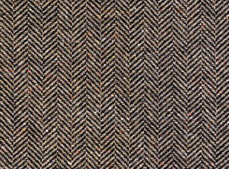 Herringbone tweed background with closeup on wool fabric texture