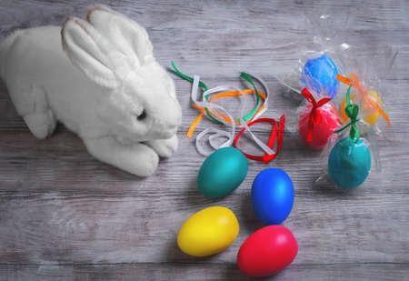 lop eared: Toy white fluffy easter bunny, gift wrapped eggs decorated with satin ribbons