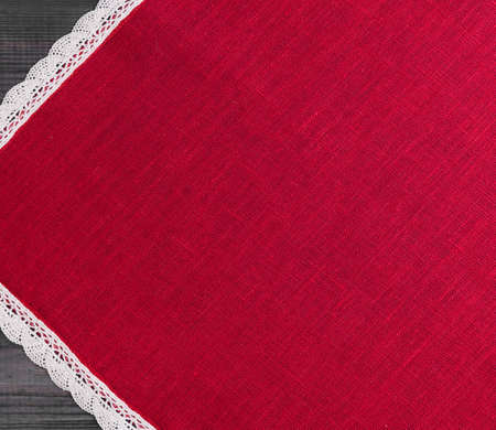 red cloth: On a gray background of wooden red cloth with white linen woven handmade lace