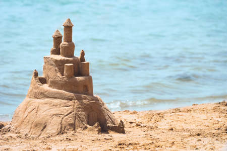 Built House sand castle on the south shore of the sandy beach blue sea Stock Photo