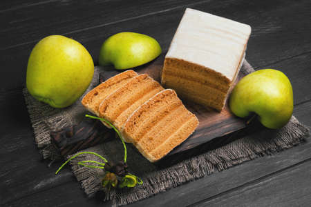 pastila: Apple biscuit Pie, fresh apples, sacking on cutting board, black wooden background surface
