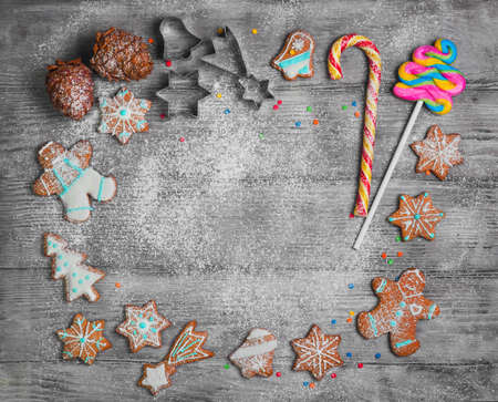 Christmas cookies, cones. New year gingerbread. Christmas card with empty space in middle of text greeting. Forms for Christmas cookies, candy cane.  Cooking Christmas cookies. Top view, blank space.