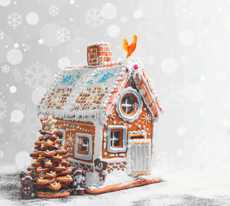 Assorted Christmas gingerbread cookies. Christmas gingerbread village, house, tree. Christmas New Years background with snowflakes. Christmas card with gingerbread house, Christmas tree, reindeer, Santa Claus
