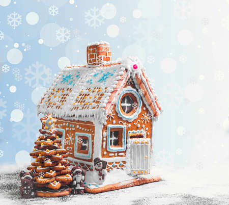 Assorted Christmas gingerbread cookies. Christmas gingerbread village, house, tree. Christmas New Year's background with snowflakes. Christmas card with gingerbread house, Christmas tree, reindeer, Santa Claus