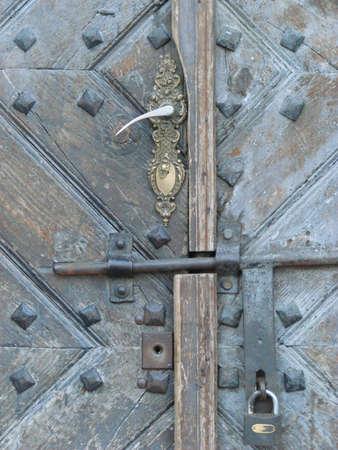 Aged door lock on wooden door Stock Photo - 731473