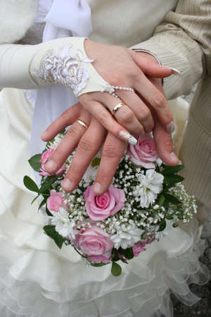 Female and male hands of newlyweds with bouquete Stock Photo - 1767949