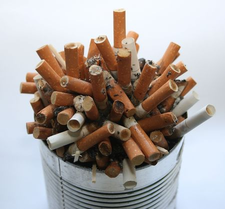 Pile of cigarette butts in ashtray 3