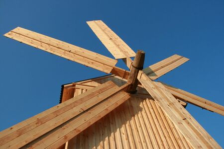 Rural wooden windmill against clear deep blue sky Stock Photo - 3666734