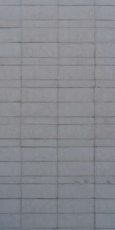 Old industrial building. Gray wall. Big concrete blocks. Stock Photo