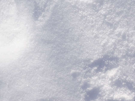 christmas ground: Top view texture of white fluffy snow crystals on the cold winter ground, Christmas background nature photo. Stock Photo