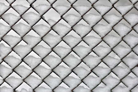 chainlink fence: Close up of a snowy chain-link fence