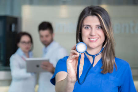 Happy smiling female doctor with stethoscope in clinic.