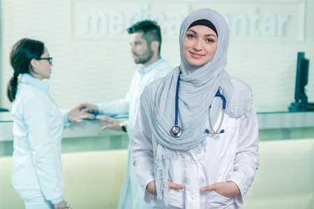 Closeup portrait of friendly, smiling confident muslim female doctor.
