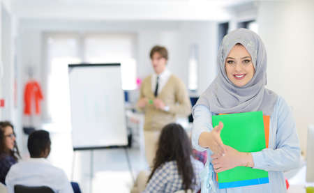 headcloth: Arabic business woman working in team with her colleagues at startup office Stock Photo