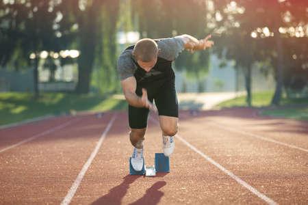 winner man: Track runner in starting position. Stock Photo