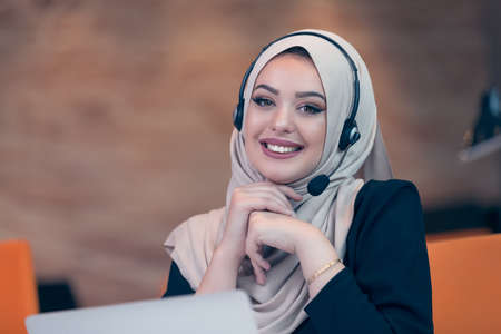Beautiful phone operator arab woman working isolated on a white background Stock Photo
