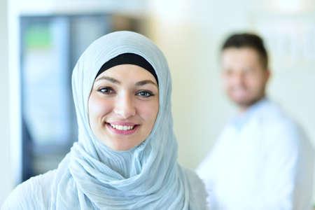 Closeup portrait of friendly, smiling confident muslim female doctor.
