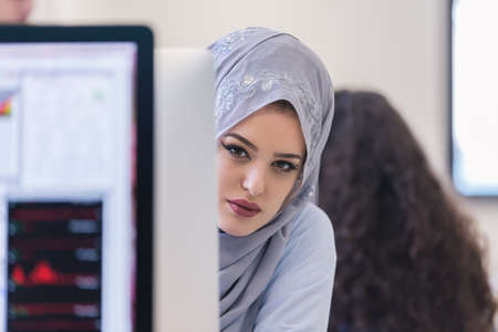 middle eastern clothing: young middle eastern businesswoman working in office