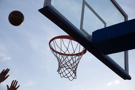 iron hoops: Basketball going through the basket Stock Photo