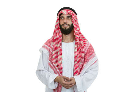 thobe: modern young arabian man looking serious isolated