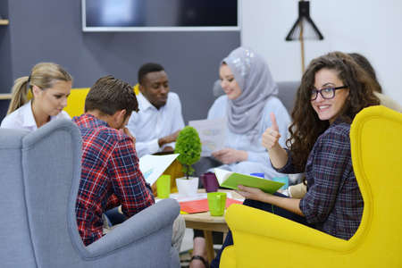 group of young business people, Startup entrepreneurs working on their venture in coworking space Stock Photo