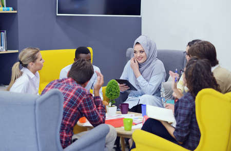 group of young business people, Startup entrepreneurs working on their venture in coworking space Фото со стока