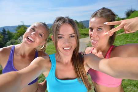 nicotine patch: three female runners make a selfie after their first workout.
