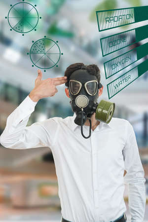 fine portrait of man with classic old gas mask with medical graphs symbols.
