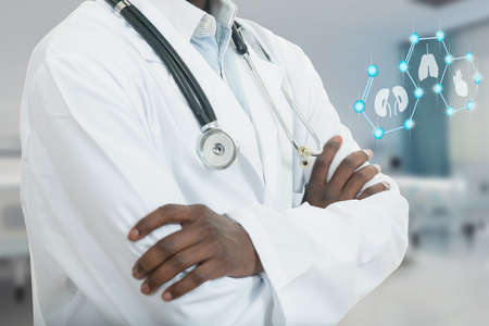 African American Medical Doctor Man With Medical Symbols Stock Photo