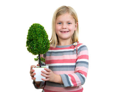 hand tool: little girl holding a plant. white background.